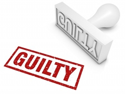 Rubber stamp showing a 'guilty' verdict.