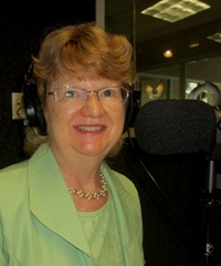 Denise Kerwin at the mic in the studios of WAVA-AM